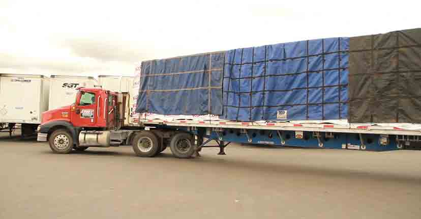 roxul has saferack install a safe flatbed tarping system