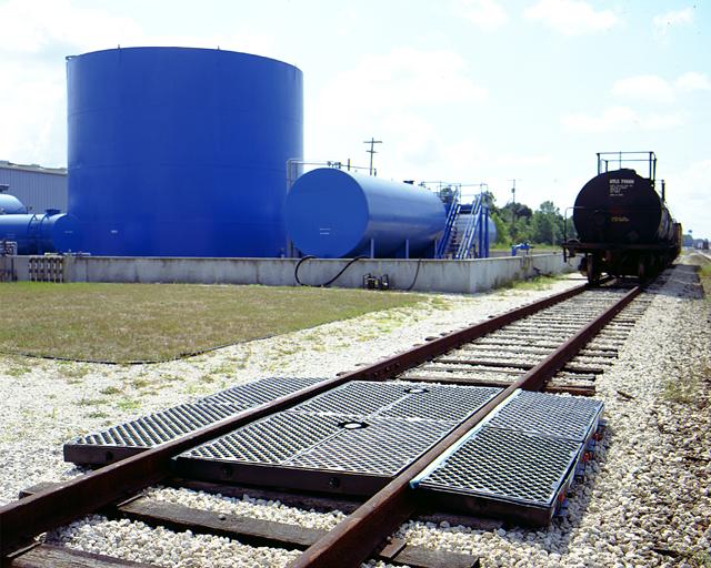 9 foot poly polyethylene railcar track pan installed