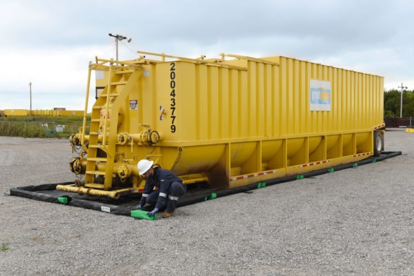 Spill containment for large capacity steel tanks