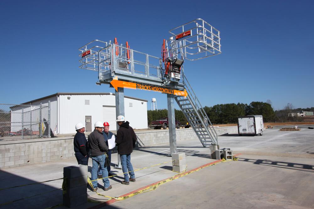 truck at track mounted loading unloading gangway on loading platform